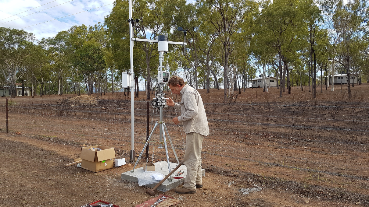 Michael Goddard installing a weather station near Laura